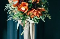a moody wedding bouquet with textural greenery, dark plum and rust flowers plus long grey ribbons