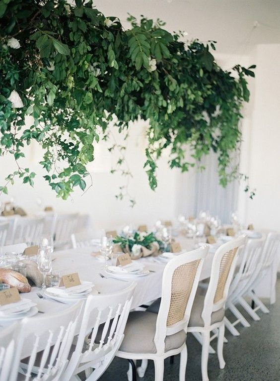 a super lush cascading wedding decoration overhead enlivens the neutral wedding reception