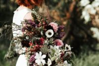 11 a moody textural fall wedding bouquet with touches of pink, plum and textural greenery