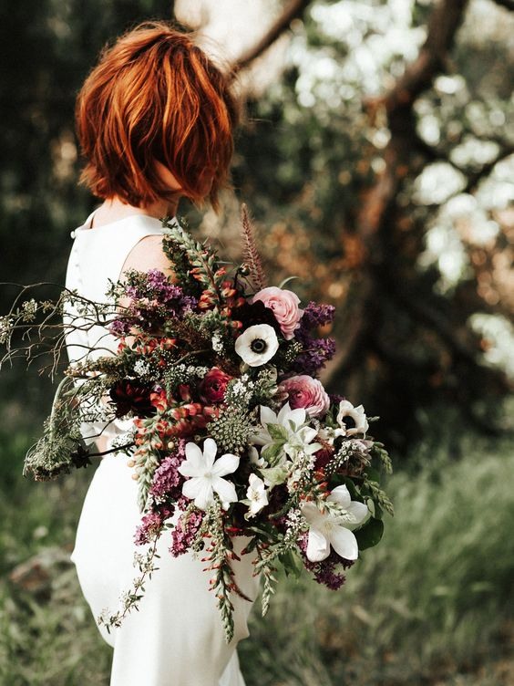 a moody textural fall wedding bouquet with touches of pink, plum and textural greenery