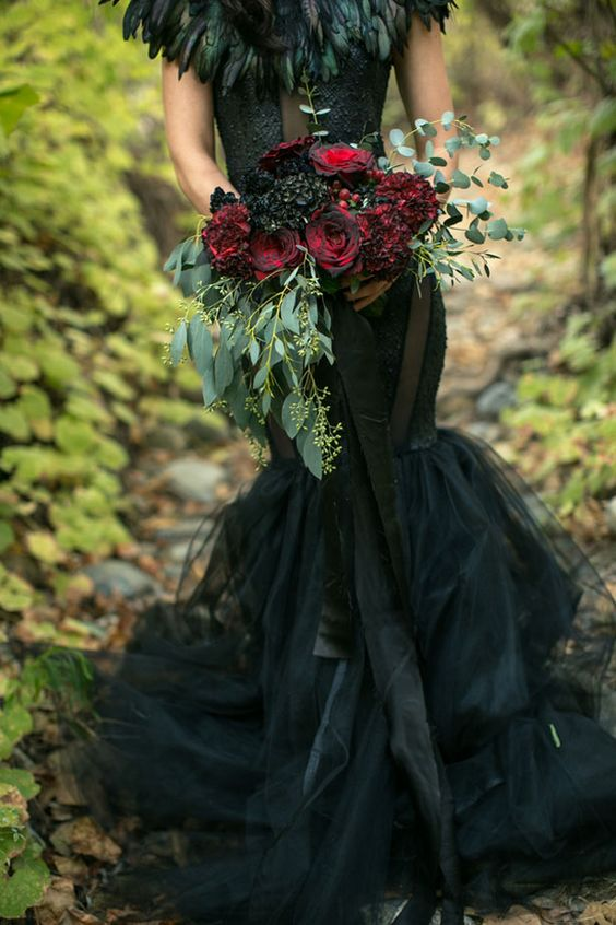 a red and black wedding bouquet is classics for Halloween and it's spruced up with eucalyptus