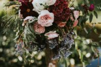 11 a tall wedding centerpiece of blush, white and plum blooms plus hanging berries