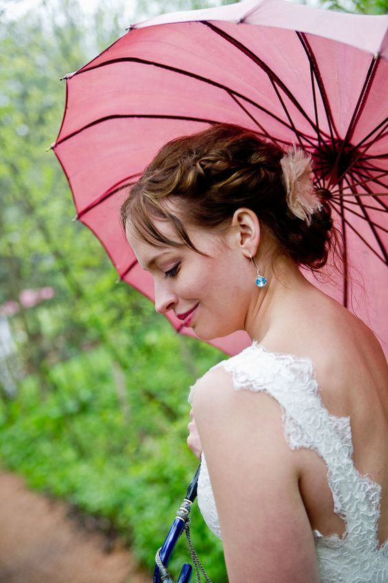add a playful and girlish touch to your bridal look with a pink umbrella
