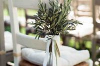 12 a chic arrangement of olive branches with a white lace bow for a non-typical aisle marker