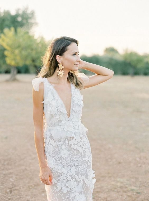 a floral couture gown with a plunging neckline and gold flower statement earrings to complement