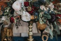 12 a moody vintage floral centerpiece of blush, ruby red, plum blooms, thistles and berries