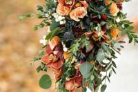 12 a moody wedding bouquet of orange and burgundy flowers, greenery and thistles plus some cascading touches