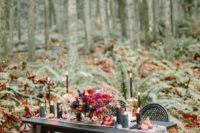12 a moody woodland sweetheart table with a grey table runner, black candles and jewel-toned florals