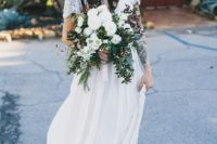 12 an airy and flowy embellished wedding dress, sandals and a black hat to create a bold boho look