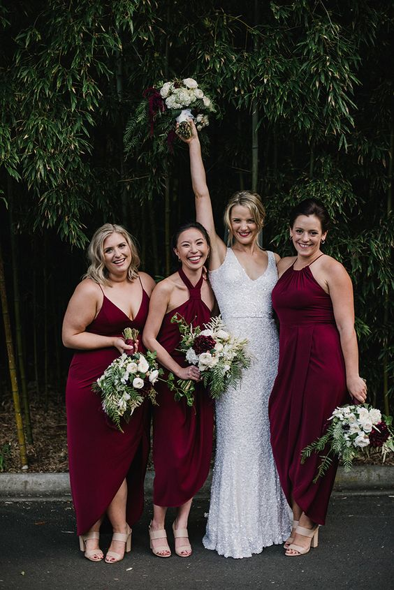 mismatching merlot-colored midi dresses with different necklines and slits for a wow look