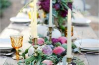 13 a gorgeous farm to table tablescape with a table runner of fruits and veggies plus greenery and amber glasses