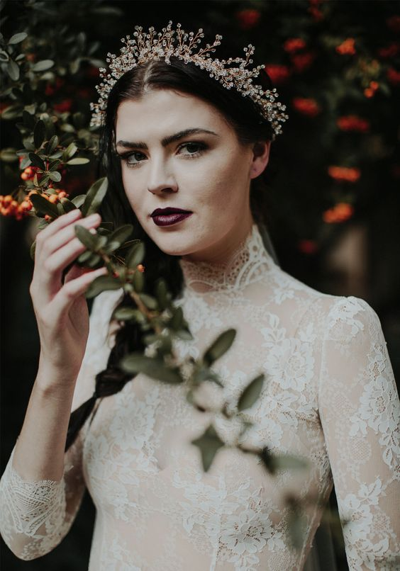 a moody bride with a sparkling rhinestone tiara to spruce up her look and make it brighter