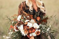 13 a moody wedding bouquet done in the shades of brown and rust plus white blooms and neutral ribbons