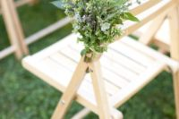 13 a textural greenery bouquet is a non-traditional yet very fresh and cool idea  to line up the aisle