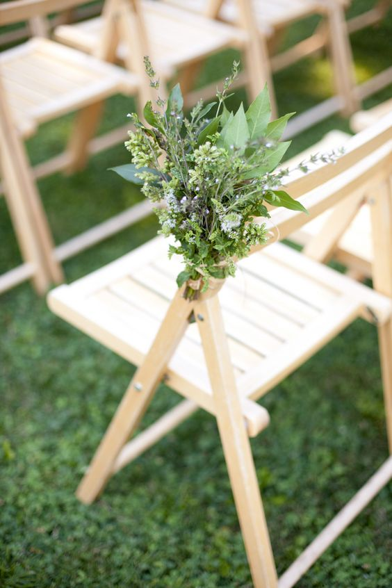 a textural greenery bouquet is a non traditional yet very fresh and cool idea  to line up the aisle