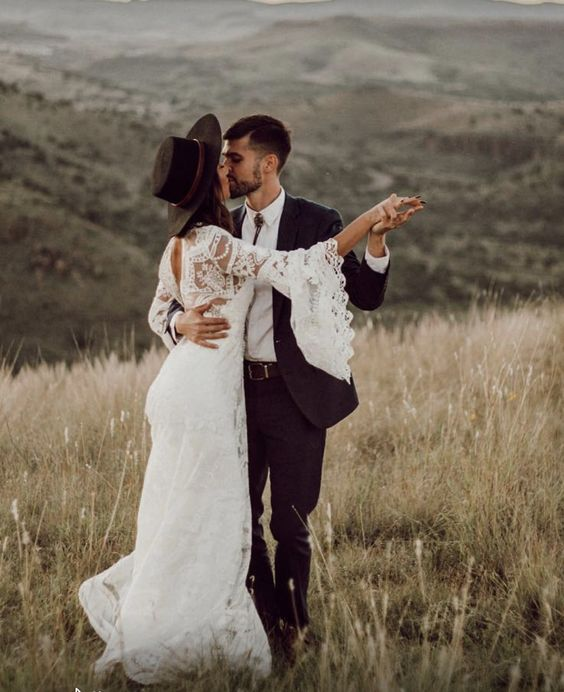 add a black hat to your lace wedding gown and you'll immediately get a more boho look