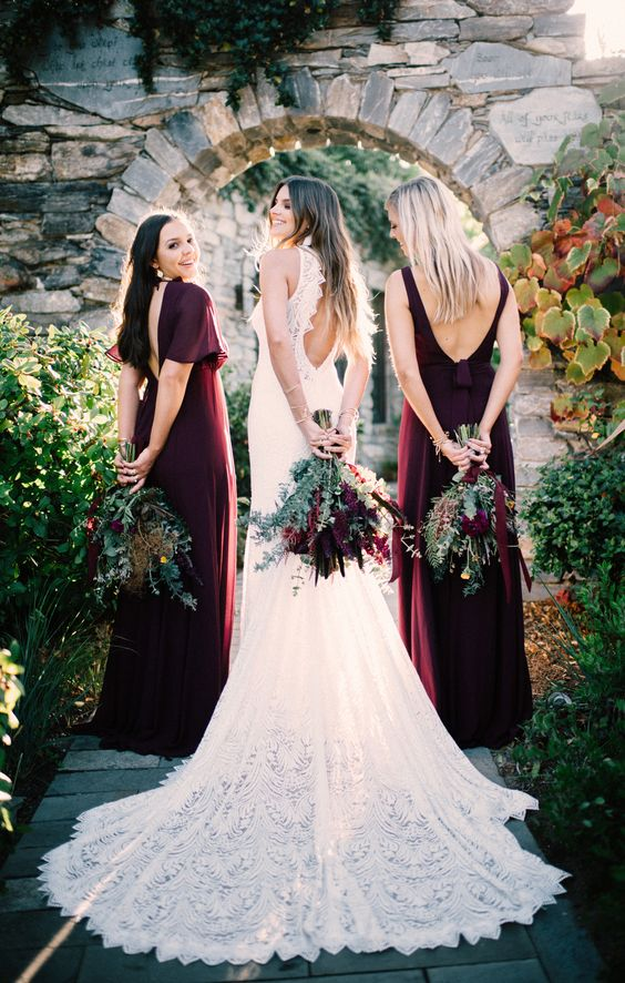 mismatching burgundy maxi dresses with cutout backs are a refined solution for a fall wedding