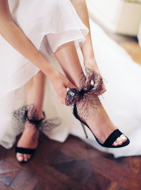 playful black wedding shoes with little veil bows will spruce up your look and will make it super girlish
