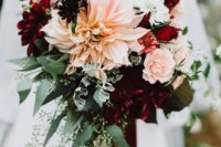 14 a bold bridal bouquet with hot red, burgundy and blush blooms plus textural greenery with burgundy ribbons
