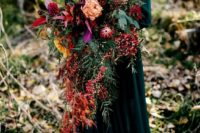 14 a cascading woodland wedding bouquet with cascading blooms and berries, greenery and colorful herbs