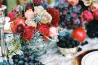 14 a chic jewel-tone wedding centerpiece with red and blush roses, thistles and pomegranates in a silver bowl
