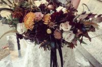 14 a moody lush wedding bouquet with dark foliage and blooms plus colored blooms