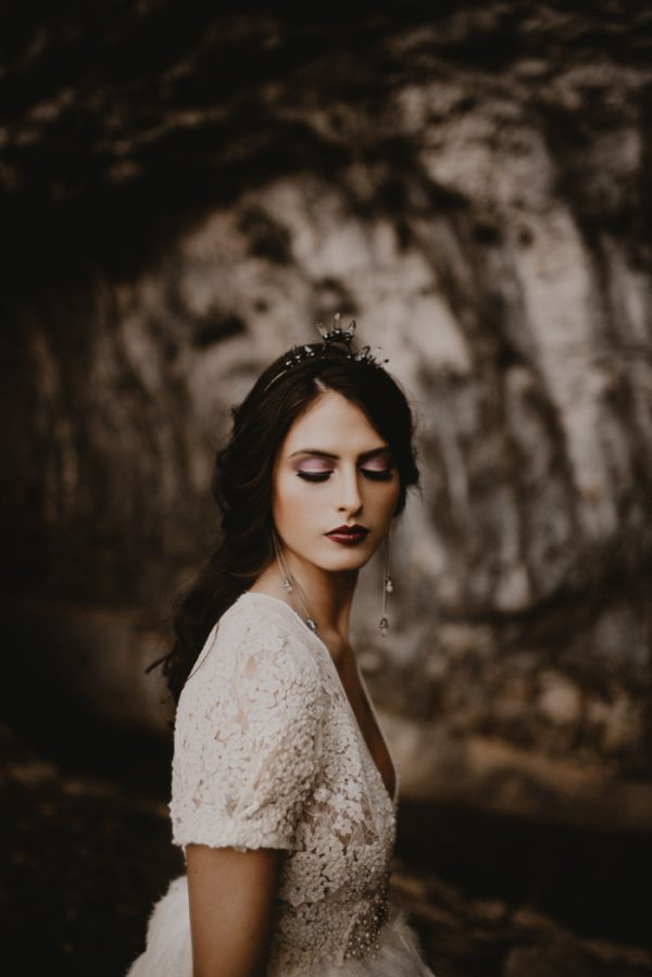 a moody winter bride rocking a black crystal tiara and statement earrings with the same crystals