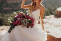 14 a white minimalist wedding dress on spaghetti straps and a white hat plus statement earrings