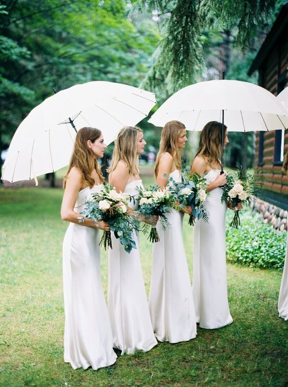 if your bridedsmaids are wearing neutrals, you may give them white or off-white umbrellas