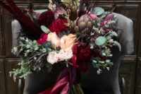 15 a luxurious wedding bouquet with feathers, artichokes, thistles, eucalyptus, deep red and burgundy blooms