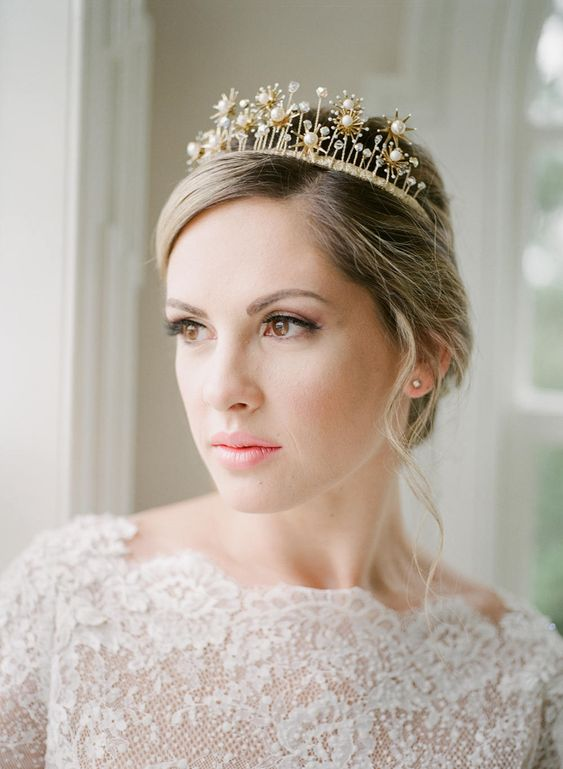 a refined bridal tiara with rhinestones and pearls for a queen-like look