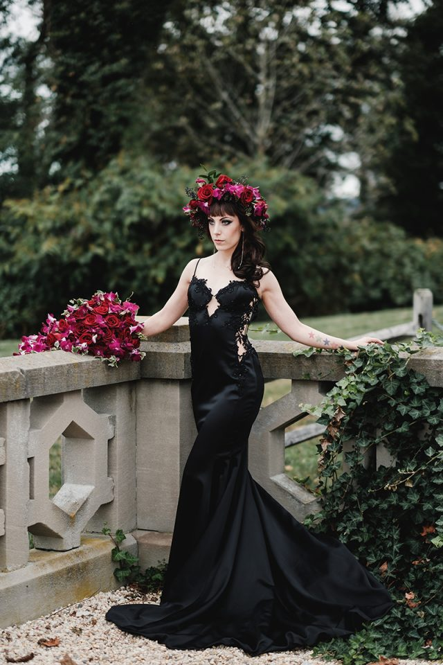 a sexy black spaghetti strap mermaid wedding gown with a lace embellished bodice and lace inserts