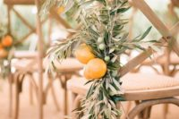 15 an arrangement of olive branches with olives and citrus for a Mediterranean wedding