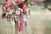 16 a Halloween wedding centerpiece of lush blooms, colorful leaves, cascading blooms and black candles