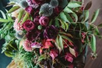 16 a bright bridal bouquet with purple, hot pink, red and blue flowers plus greenery and yellow ribbons