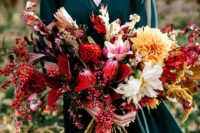 16 a lush and textural fall woodland wedding bouquet with colorful leaves, herbs and blooms