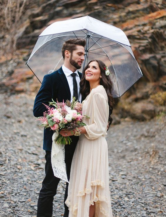 let your partner hold an umbrella above you to show off protection and care