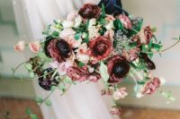 17 a bright wedding bouquet with blush and burgundy blooms with greenery for a romantic feel