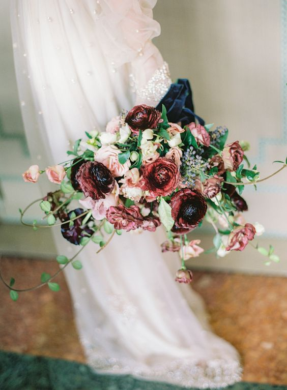 a bright wedding bouquet with blush and burgundy blooms with greenery for a romantic feel