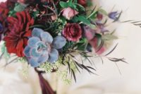17 a chic moody wedding bouquet with dark blooms, pale succulents and textural greenery plus burgundy ribbons
