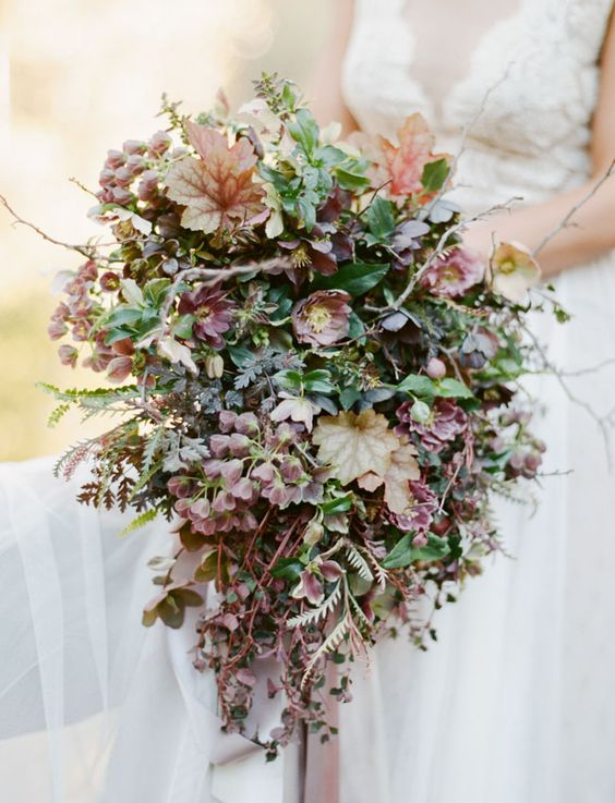 a textural fall wedding bouquet with grene and brown and burgundy blooms and leaves