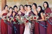 17 bridesmaids' dresses in the shades of red, purple, burgundy, all different and of different fabrics