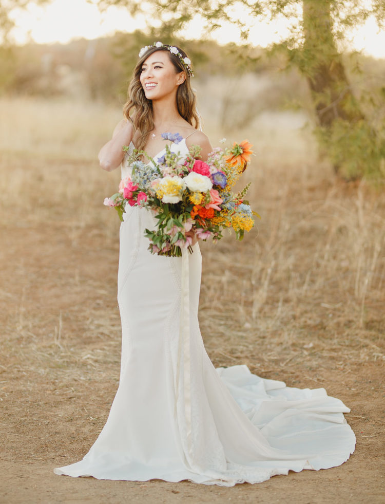 highlight your plain slip wedding gown with a bold bouquet that will contrast it a lot