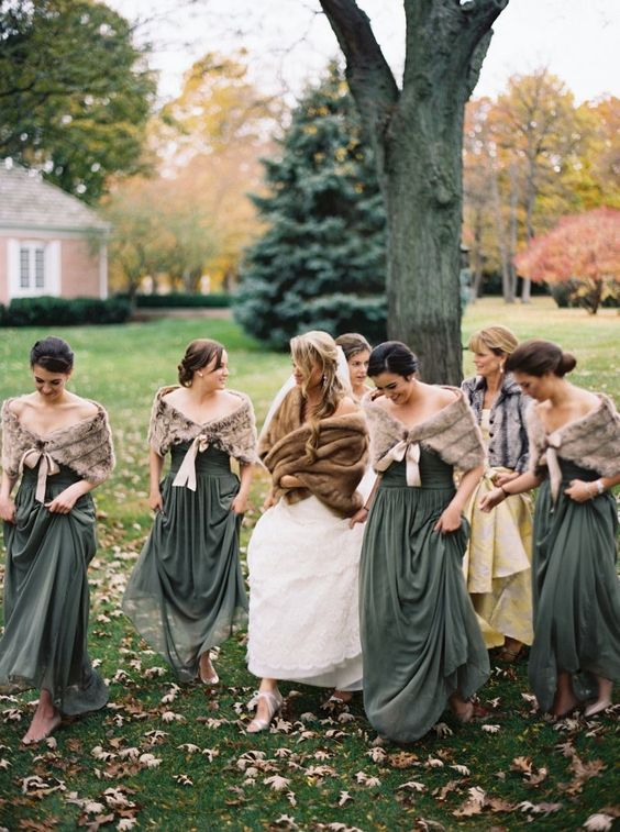 maxi green dresses with draped skirts and neutral faux fur stoles for a chic look