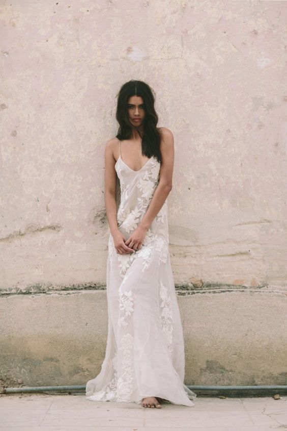 a chic off-white slip wedding gown with white lace floral appliques are all a boho bride needs