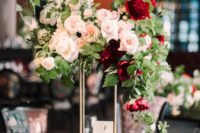 18 a luxurious fall wedding centerpiece made of burgundy and blush blooms and greenery on a tall stand