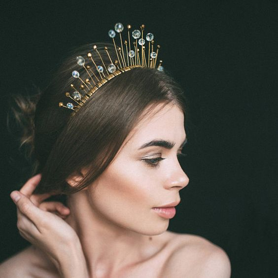 a unique and creative bridal tiara with beams and large rhinestones for a statement