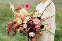 18 a wild fall wedding bouquet with fall leaves, pink blooms and cascading greenery plus ribbons