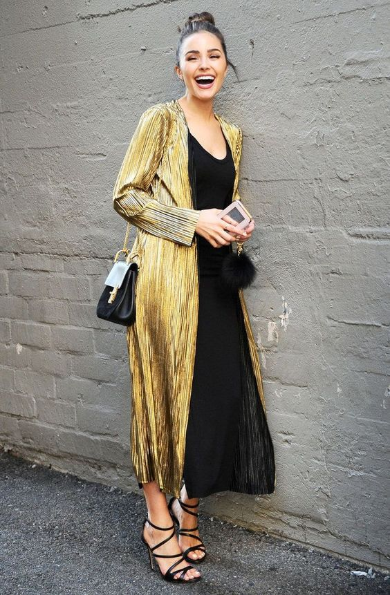a black slip dress, black strappy shoes, a gold trench and a black bag for a wow look