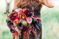 19 a colorful wedding bouquet with pink, hot pink and black callas plus cascading blooms and leaves